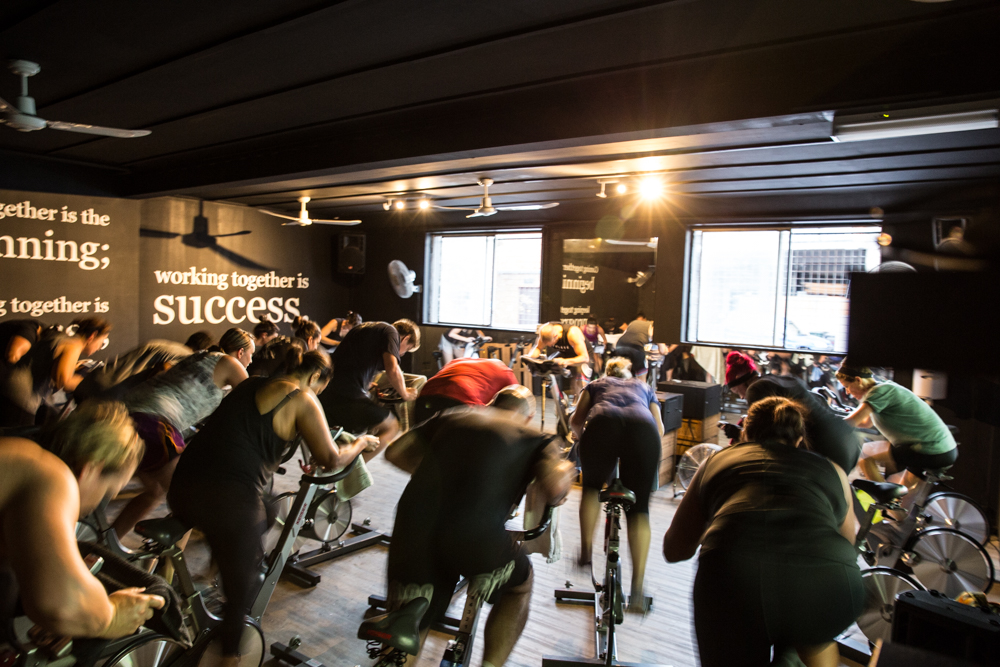 Indoor Cycling studio full with people mid sprint