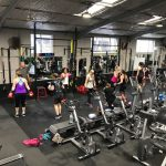 partners pad work for boxing class at Marrickville gym
